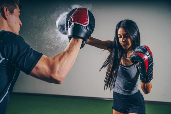woman boxing gloves, woman boxing shorts with punching bags