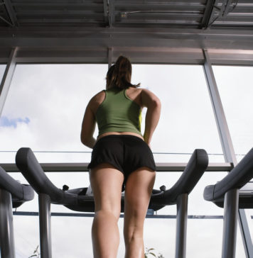 Young Woman Jogging on Treadmill