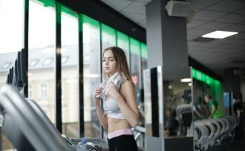 Riding a Stationary Bike Bad for Your Knees? - young attractive girl on treadmill